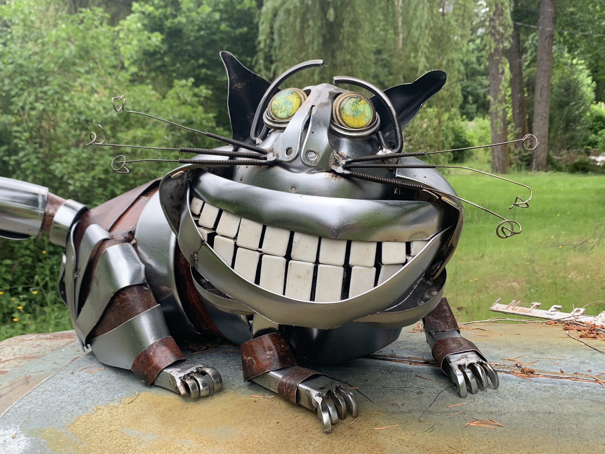 """""""Cheshire Cat"""" - welded steel and found object sculpture by Jud Turner, copyright 2020"""