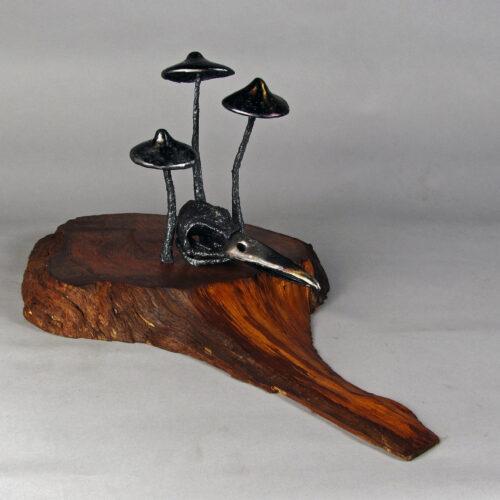 Mycelia Cycle - welded steel sculpture of raven skull and mushrooms